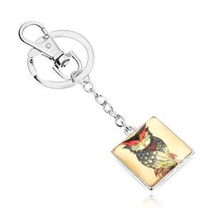 Kľúčenka kabošon, štvorec s vypuklým sklom, nahnevaná sova, žltý podklad