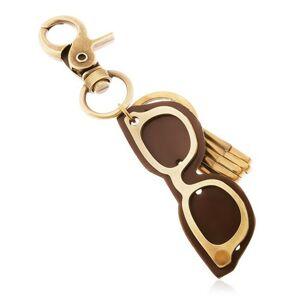 Kľúčenka v mosadznej farbe s patinovaným povrchom, okuliare z kože a kovu